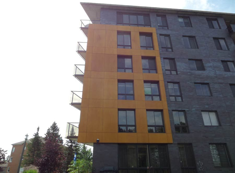 Side view of condos finished in yellow and gray